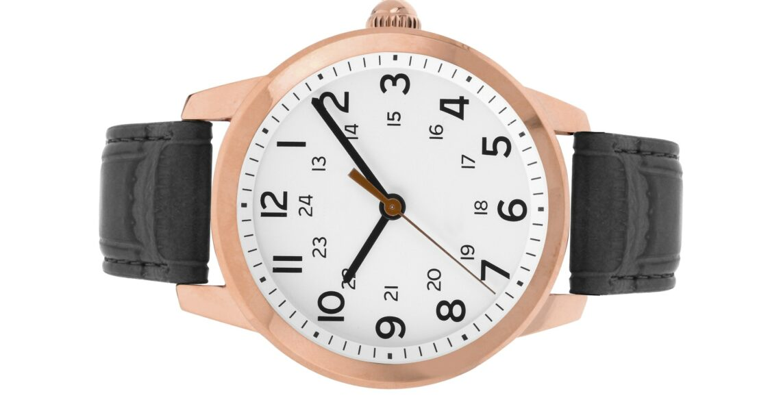 luxury watches with a leather strap on a white background
